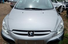Need to sell gold 2003 Peugeot 307 at price ₦1,200,000 in Abuja