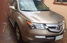 Need to sell super clean gold 2009 Acura MDX