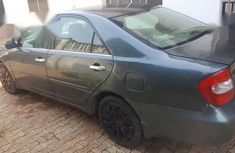 Blue 2003 Toyota Camry sedan automatic at mileage 89,743 for sale