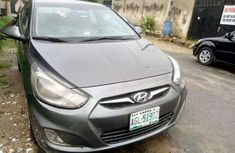 Sell well kept brown 2012 Hyundai Accent automatic at mileage 100,000