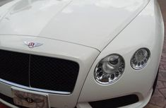 Selling white 2014 Bentley Continental automatic at mileage 3,256