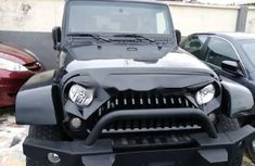 Sell black 2011 Jeep Wrangler automatic at cheap price