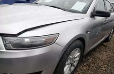 Neatly used grey 2013 Ford Taurus automatic in Lagos