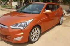 Sell cheap orange 2013 Genesis Coupe sedan automatic at mileage 27,000