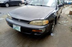 Selling grey/silver 1997 Toyota Camry automatic