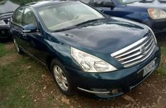 Best priced green 2009 Nissan Teana at mileage 86,521