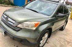Need to sell cheap used green 2009 Honda CR-V at mileage 67,363