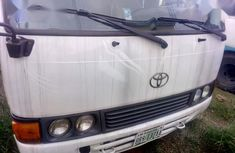 Need to sell white 2010 Toyota Coaster at mileage 82,314