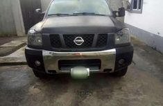 Need to sell black 2009 Nissan Titan at mileage 100,000