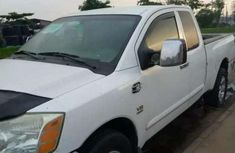 Selling white 2004 Nissan Titan pickup automatic in Lagos