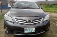 Sell grey/silver 2013 Toyota Corolla coupe automatic at cheap price