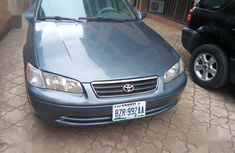 Need to sell blue 2001 Toyota Camry at mileage 86,000 in Abakaliki