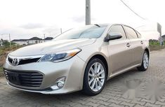 Need to sell cheap used brown 2013 Toyota Avalon sedan