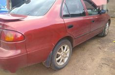 Selling red 2001 Toyota Corolla automatic at price ₦850,000