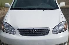 Need to sell high quality white 2002 Toyota Corolla sedan automatic
