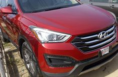 Best priced used red 2013 Hyundai Santa Fe automatic