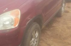 Selling red 2002 Honda CR-V automatic in Lagos