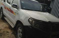 White 2006 Toyota Hilux manual at mileage 125,000 for sale in Lagos