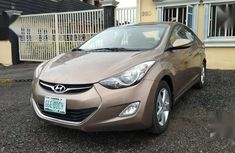 Well maintained gold 2013 Hyundai Elantra sedan for sale in Lagos