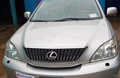 Best priced silver 2006 Lexus RX at mileage 128,232 in Lagos