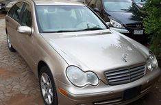 Sell super clean gold 2006 Mercedes-Benz C230 automatic