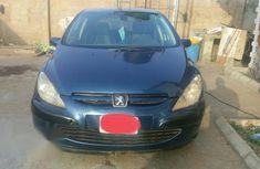 Need to sell blue 2002 Peugeot 307 at price ₦500,000