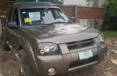 Sell very cheap clean brown 2004 Nissan Frontier in Lagos