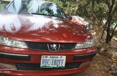Clean and neat red 2005 Peugeot 406 sedan at price ₦750,000 in Abakaliki