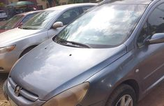 Need to sell high quality grey 2005 Peugeot 307 automatic in Abuja