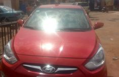 Red 2013 Hyundai Accent sedan automatic for sale in Lagos