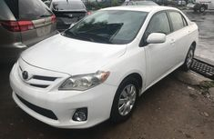 Very sharp neat white 2011 Toyota Corolla for sale in Lagos