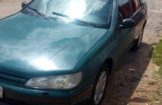 Best priced green 1999 Peugeot 406 manual in Kaduna