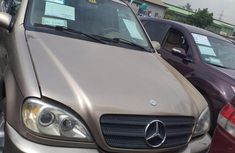 Well maintained gold 2002 Mercedes-Benz M-Class automatic for sale