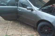 Selling grey/silver 2004 Toyota Camry sedan automatic in Awka