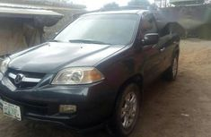 Need to sell high quality black 2005 Acura MDX automatic at price ₦1,250,000