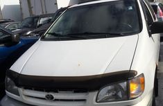Clean white 2002 Toyota Sienna automatic for sale at price ₦1,450,000