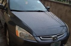 Need to sell high quality grey 2004 Honda Accord automatic at price ₦800,000