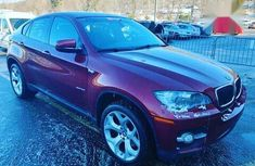 Sell well kept red 2008 BMW X6 sedan at price ₦11,500,000