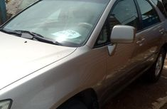 Neatly used gold 2002 Lexus RX automatic in Lagos