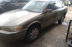 Used gold 1998 Toyota Camry automatic at mileage 160,000 for sale
