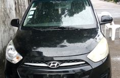 Sell cheap black 2015 Hyundai i10 hatchback automatic at mileage 25,000