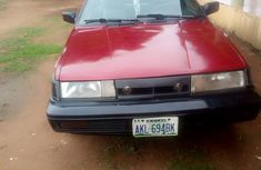 Well maintained red 1998 Nissan Sunny at mileage 120,000 for sale