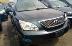 Best priced green 2006 Lexus RX at mileage 85,247 in Lagos