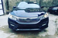 Selling black 2016 Honda Accord automatic in good condition in Lagos