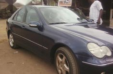Best priced blue 2004 Mercedes-Benz C180 automatic in Lagos