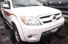 Sell cheap white 2008 Toyota Hilux pickup automatic in Lagos