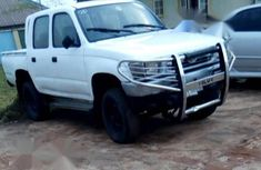 Best priced white 1998 Toyota Hilux pickup at mileage 169,900
