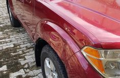Sell well kept red 2007 Nissan Pathfinder automatic at price ₦1,500,000