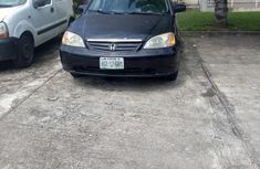 Black 2002 Honda Civic car at attractive price in Lagos