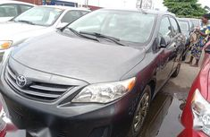 Sell very cheap clean grey 2013 Toyota Corolla in Lagos